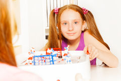 Cute girl playing ice hockey table board game Royalty Free Stock Images