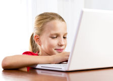 Cute girl playing on the laptop Royalty Free Stock Image