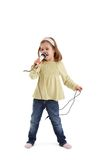 Cute girl playing with microphone Stock Photos