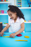 Cute girl playing with modeling clay Stock Photography