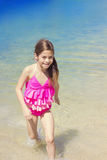 Cute Girl Playing in the Ocean on Vacation Royalty Free Stock Image