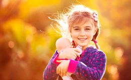 Cute girl playing outside Stock Image