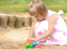 Cute girl playing on sand Stock Photo