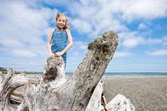 Cute girl playing on a sandy beach Royalty Free Stock Photo