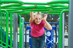 Cute girl playing on a school playground Stock Photo