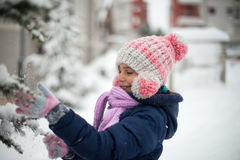 Cute Girl Playing With Snow. Cute little girl playing with snow in park. Winter is magic Stock Photos