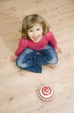Cute girl playing with spinner Stock Image
