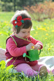 Cute girl playing in spring lawn Royalty Free Stock Photos