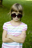 cute girl playing spy in park Royalty Free Stock Photos