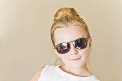 Cute girl playing with sunglass Royalty Free Stock Images