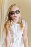 Cute girl playing with sunglasses Royalty Free Stock Photography