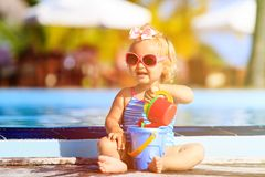 Cute girl playing in swimming pool at the beach Stock Photography