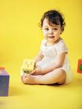Cute girl playing toy bricks Stock Image