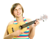Cute girl playing an ukulele Royalty Free Stock Image