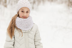Cute girl playing in a winter forest. Royalty Free Stock Photo