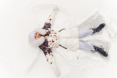 Cute girl playing in a winter forest. Royalty Free Stock Photos