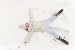 Cute girl playing in a winter forest. Stock Images