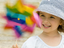 Cute Girl Playing With Windmill Stock Image