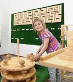 Cute  girl playing with wooden puzzles. Stock Images