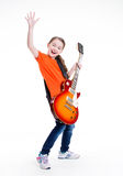 Cute girl plays on the electric guitar. Stock Image