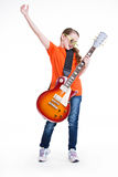 Cute girl plays on the electric guitar. Royalty Free Stock Photos