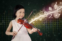Cute girl plays violin on stage Stock Photo