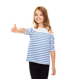Cute girl pointing in the air or virtual screen Royalty Free Stock Photos