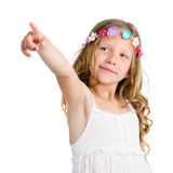 Cute girl pointing with finger. Royalty Free Stock Photo
