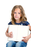Cute girl pointing with finger on blank book . Royalty Free Stock Image