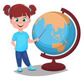 Cute girl points to the globe with a pointer. Pretty little sch Royalty Free Stock Photography