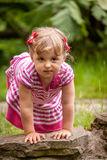 Cute girl by the pond Royalty Free Stock Photography