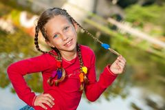 Cute girl with ponytails outdoors. Stock Photo