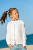Cute girl with ponytails at seaside. Royalty Free Stock Photo