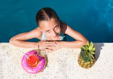 Girl in a pool Royalty Free Stock Image
