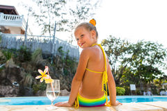 Cute girl at the pool Stock Photos