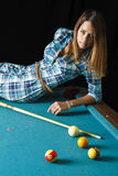 Cute girl on pool table Royalty Free Stock Images