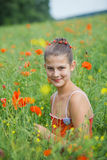 Cute girl in poppy field Royalty Free Stock Photos