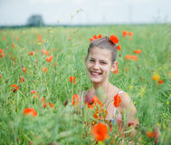 Cute girl in poppy field Stock Image