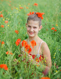 Cute girl in poppy field Stock Photography
