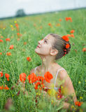 Cute girl in poppy field Stock Photo