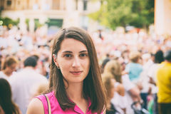 Cute Girl Portrait With Crowd Of People On Background Royalty Free Stock Images