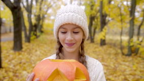 Cute girl portrait with jack o`lantern on Halloween stock video