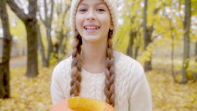 Cute girl portrait with jack o`lantern on Halloween stock footage