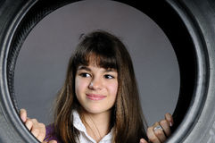 Cute girl portrait standing on tyres Royalty Free Stock Photography