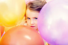 Cute girl posing with balloons, close-up Royalty Free Stock Photography