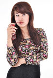 Cute girl posing and biting glasses Stock Image