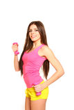 Cute girl posing with dumbbells on a white background Royalty Free Stock Photo
