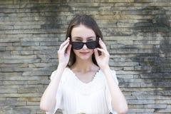 Free Cute Girl Posing In Sunglasses Stock Image - 133506201