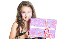 Cute girl posing. Little Girl and gift isolated on white Stock Photography