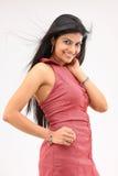 Cute girl posing sidewards Royalty Free Stock Images